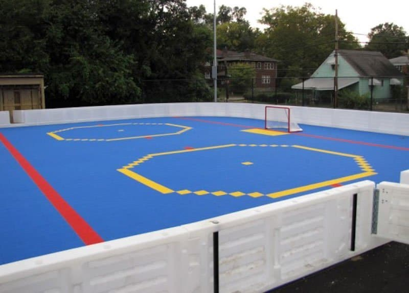 Outdoor roller rink with plastic boards