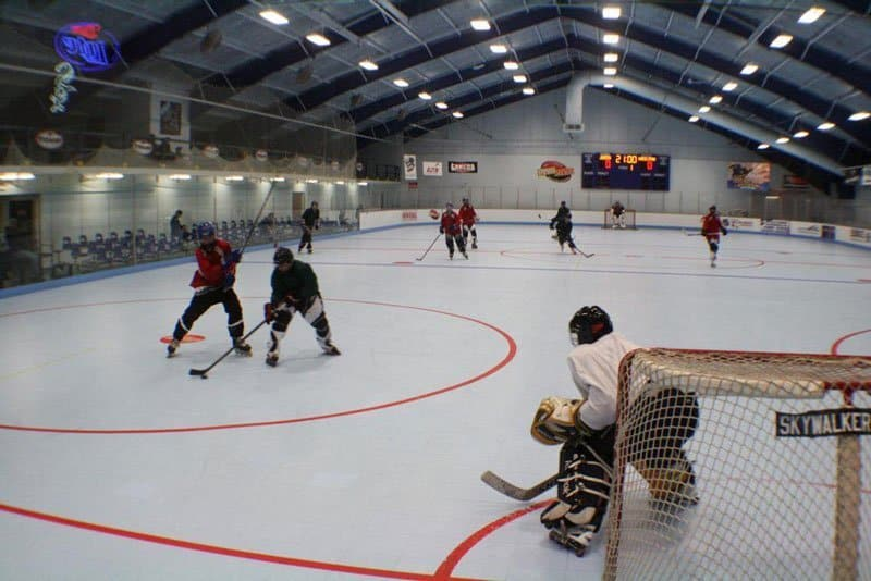 Players dueling for position in a game of roller hockey