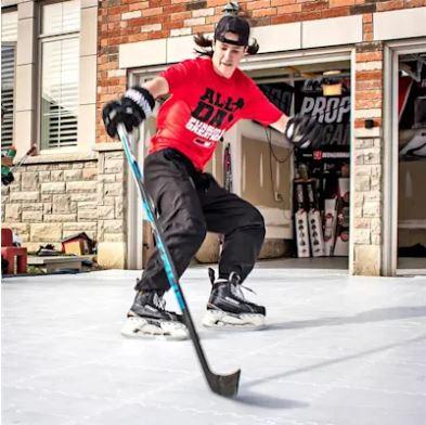 Photo of Player Skating On Hockey Shot Tiles