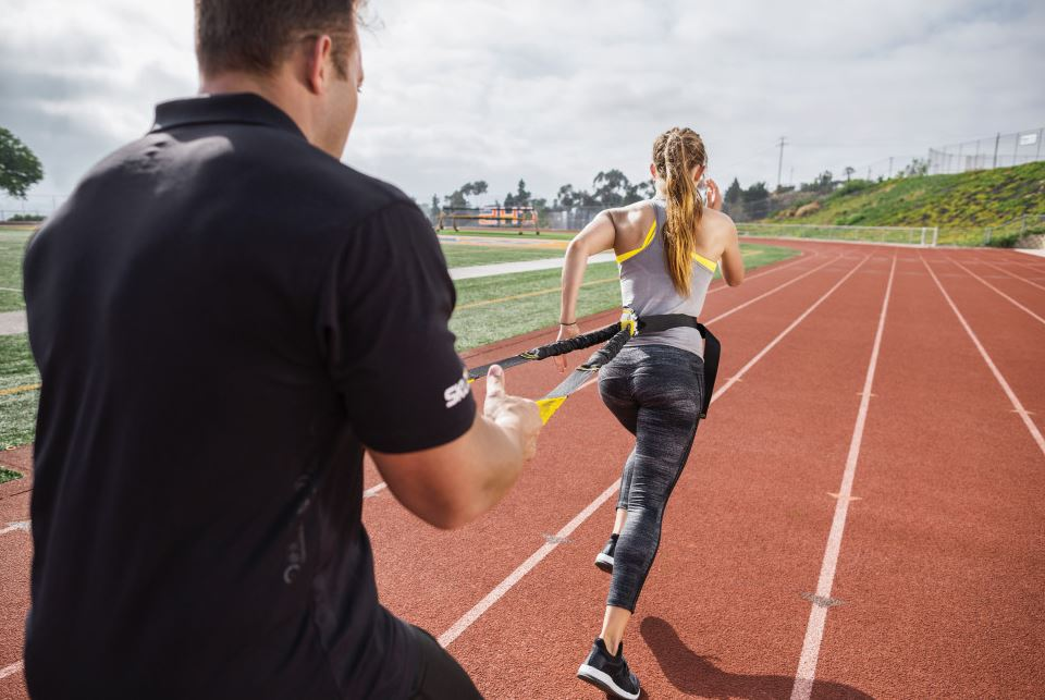 Photo of two people using SKLZ Acceleration Trainer